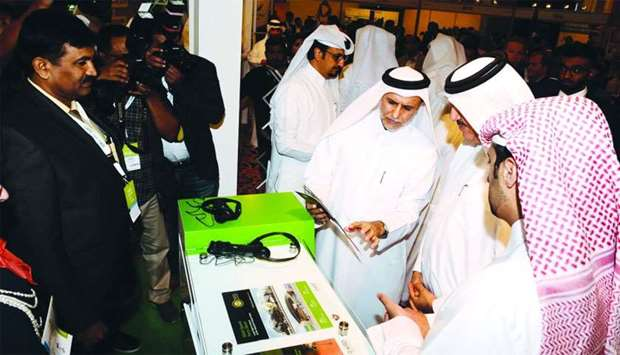 Dr Yousef Alhorr explains a green building product to the minister and guests
