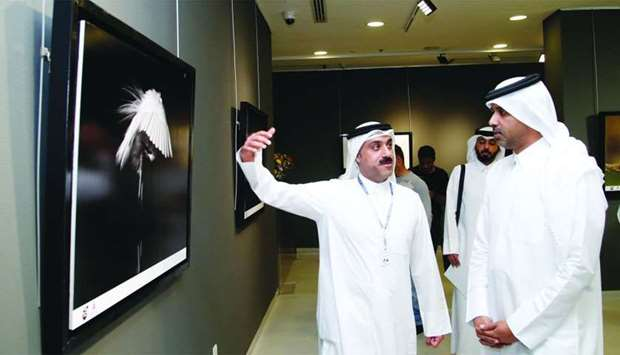 Yacoub al-Kanderi (left) shows his works to Saif Saeed al-Dosari, who opened the Kuwait exhibition '