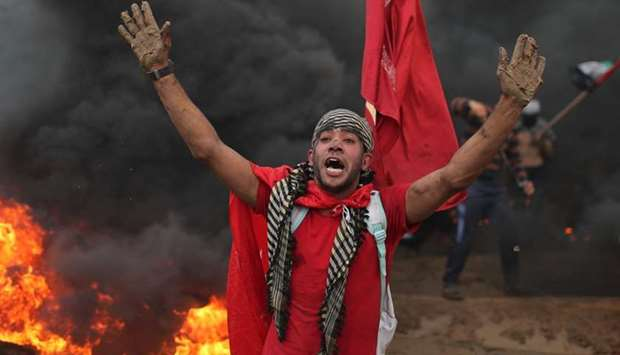 A Palestinian demonstrator reacts during a protest calling for lifting the blockade on Gaza, at the