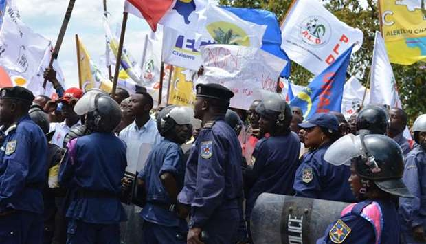 DRCongo policemen escort protesters during a march in Goma.
