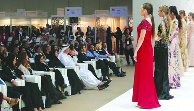 A collection of abayas, jalabiyas and evening gowns by leading fashion brands globally on centre sta