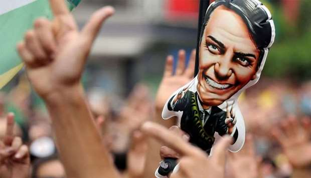 Supporters of presidential candidate Bolsonaro attend a demonstration in Sao Paulo