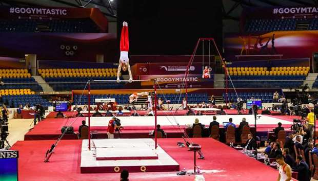 A view of contenstants competing in the men's parallel bars qualification at the 2018 FIG Artistic G