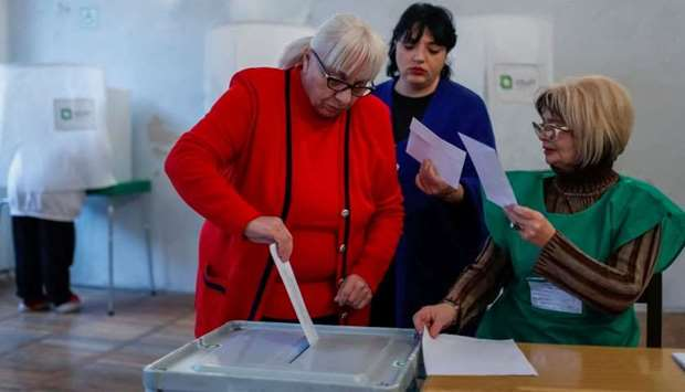People vote at a polling station during presidential election in Tbilisi