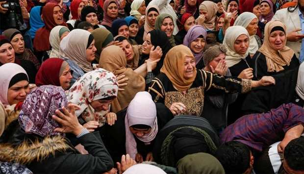 Palestinian mourners react during the funeral