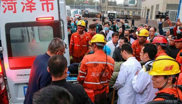 rescuers and medical staffs transferring an injured miner after a mining accident in Yuncheng County