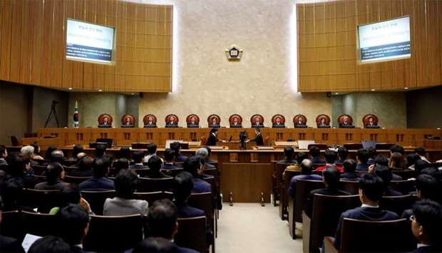 Judges of South Korea's Supreme Court sit as Lee Choon-shik (obscured), victim of wartime forced lab