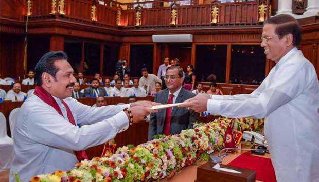 Sri Lanka's newly appointed PM Mahinda Rajapaksa is sworn in as the Minister of Finance and Economic