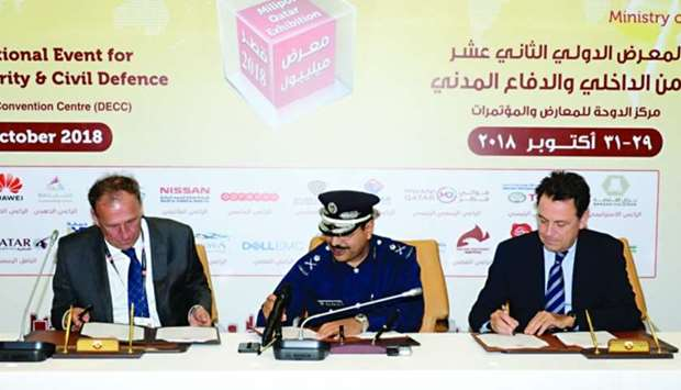 Major General Nasser bin Fahad al-Thani flanked by GIE Milipol chairman Yann Jounot and ComexposiumC