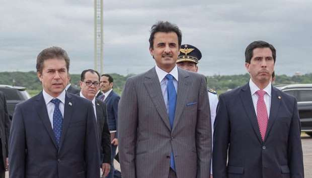 His Highness the Amir Sheikh Tamim bin Hamad al-Thani is being greeted on arrival at a reception cer