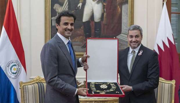 His Highness the Amir Sheikh Tamim bin Hamad al-Thani being honoured with Mariscal Lopez necklace by