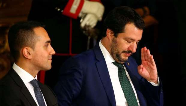 Interior Minister Matteo Salvini gestures next to Italy's Minister of Labor and Industry Luigi Di Ma