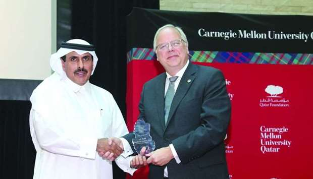 HE Sheikh Abdulla receives a token of recognition from Carnegie Mellon University in Qatar dean Tric