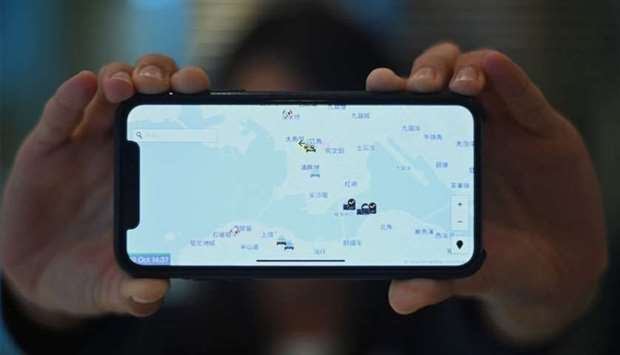 """A smartphone displaying the """"HKmap.live"""" app in Hong Kong"""