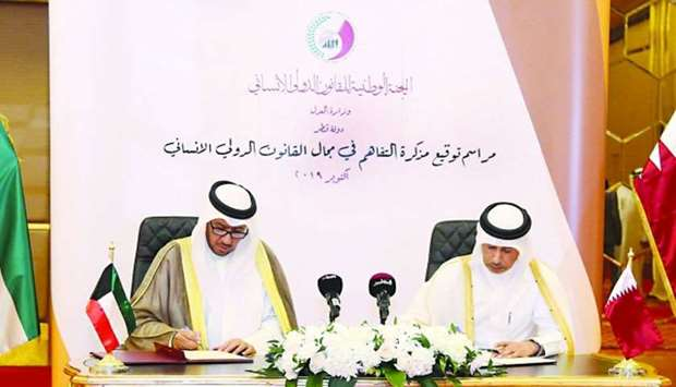 HE Dr al-Nuaimi and Dr al-Afasi sign the MoU on Thursday