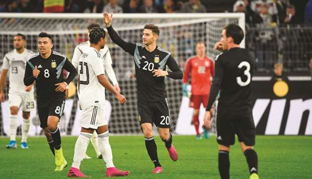 Argentina's forward Lucas Alario (centre) celebrates scoring a goal during the friendly game against