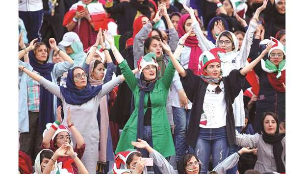 Iranian women cheer during the World Cup Qatar 2022 Group 'C' qualification match between Iran and C