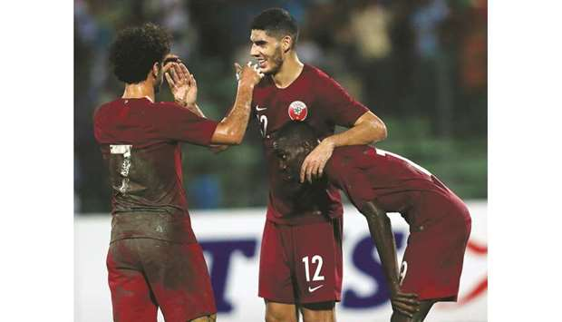 Karim Boudiaf (C) celebrates with teammates after scoring Qatar's second goal against Bangladesh in