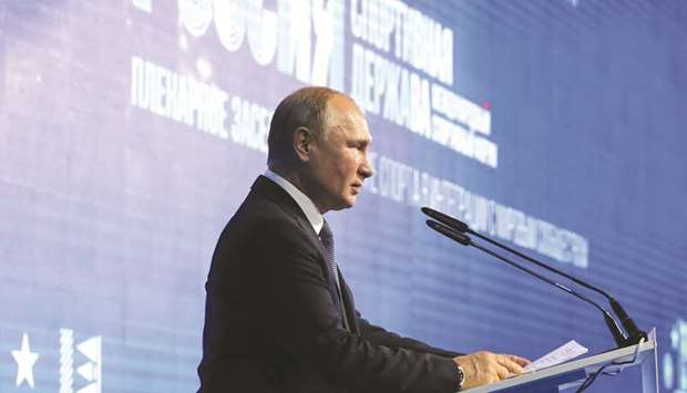Russian President Vladimir Putin gives a speech at a sports 