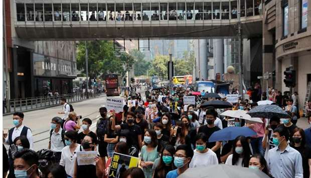 People protest against what they say is the abuse of pro-democracy protesters by Hong Kong police, a