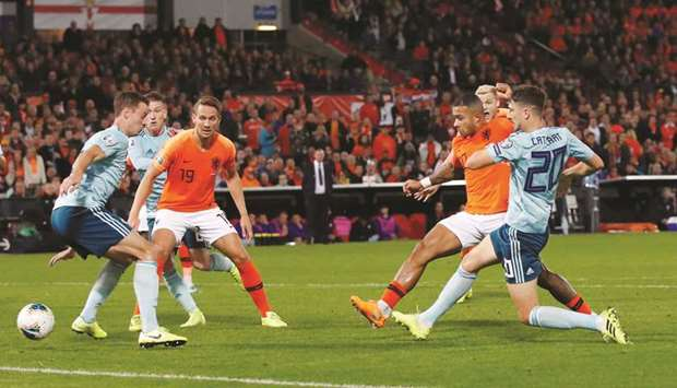 Netherlands' Memphis Depay (second right) scores against Northern Ireland during the Euro 2020 Quali