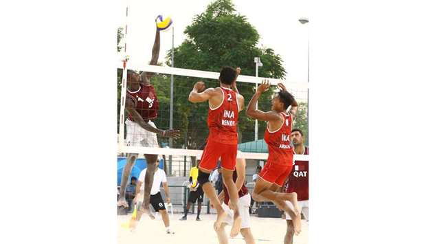 Qatar's Cherif Younousse (left) in action during the beach 4x4 volleyball match against Indonesia in