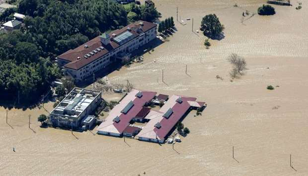 This aerial view shows the flooded Kawagoe Kings Garden nursing home besides the Oppegawa river in K
