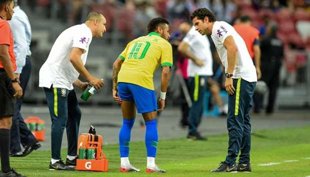Brazil's forward Neymar (C) leaves the field during an international friendly football match between