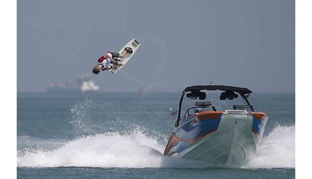 Maxime Roux of France executes a somersault during the Men's 