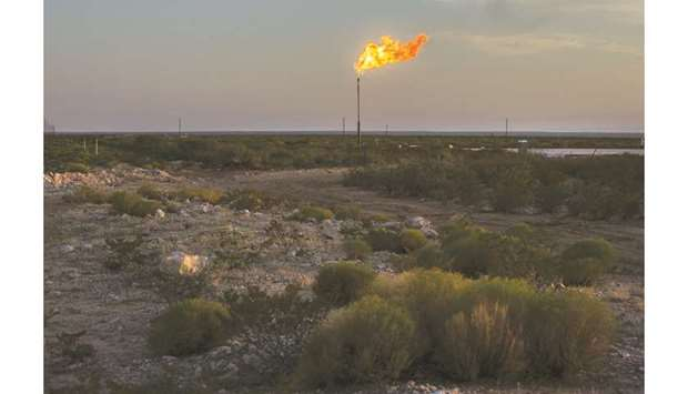 A gas flare burns at dusk in the Permian Basin in Texas, US (file). The S&P 500 Oil & Gas Exploratio