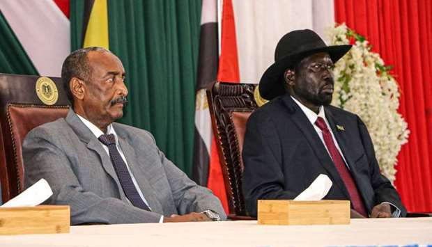 President of Sudanese Transitional Council General Abdel Fattah al-Burhan (L) and President of South
