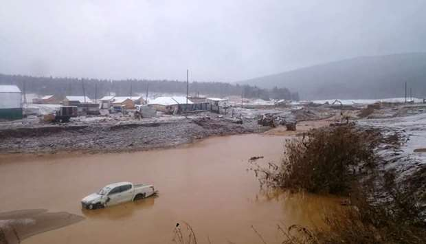 Flooding after a dam failure in a gold miners village close to the town of Shchetinkino, about 250 k