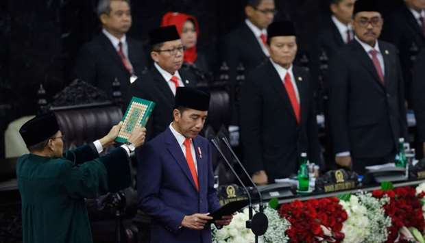 Joko Widodo (front R) takes his oath as Indonesia's President for his second five-year term during a