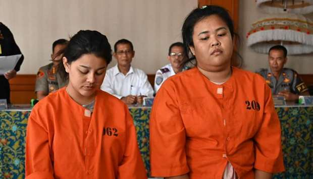 Kasarin Khamkhao (L) and Sanicha Maneetes from Thailand (R) attend a press conference at the customs