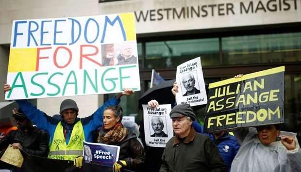 Demonstrators protest outside of Westminster Magistrates Court, where a case management hearing in t