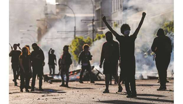 Demonstrators are seen at a barricade during protests in Valparaiso, Chile on Sunday.