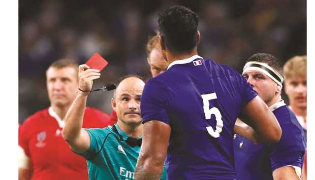 France's Sebastien Vahaamahina is shown a red card by South African referee Jaco Peyper during their