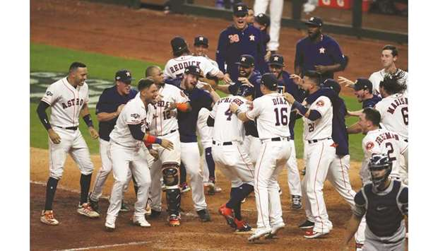 Houston Astros celebrate after defeating the New York Yankees in game six of the ALCS playoff baseba