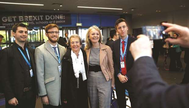 Secretary of State for International Trade Liz Truss poses for a picture with attendees at the venue