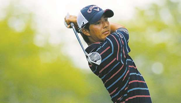 File photo of Ryo Ishikawa of Japan hitting from the 12th tee during a practice round at the 2014 PG