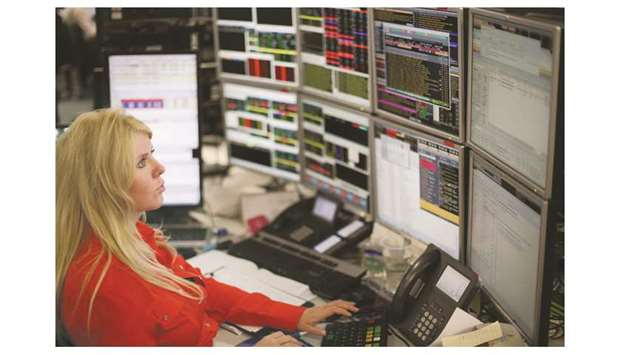 A trader is seen at the London Stock Exchange. The FTSE 100 index climbed 0.7% to 7,260.74 points ye