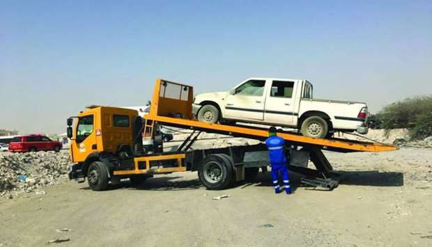 An abandoned vehicle being taken away in Al Rayyan's Municipality