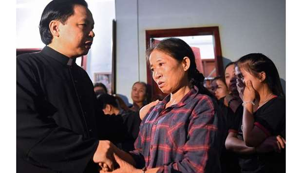 Tran Thi Hien (C), mother of Bui Thi Nhung, who is feared to be among the 39 people found dead in a