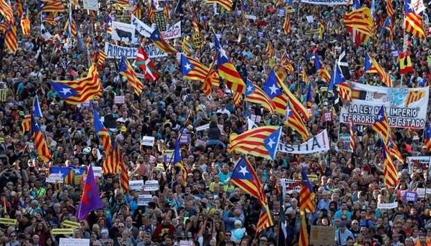 Catalan pro-independence demonstrators attend a protest to call for the release of jailed separatist