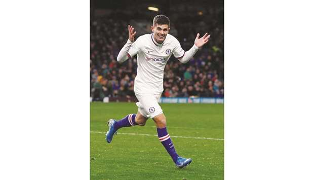 Chelsea's Christian Pulisic celebrates scoring their third goal to 