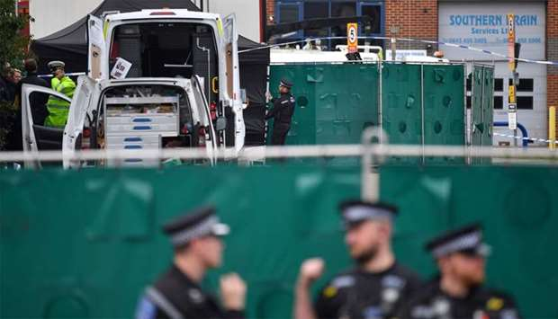 British Police officers work near a lorry, believed to have originated from Bulgaria, and found to b