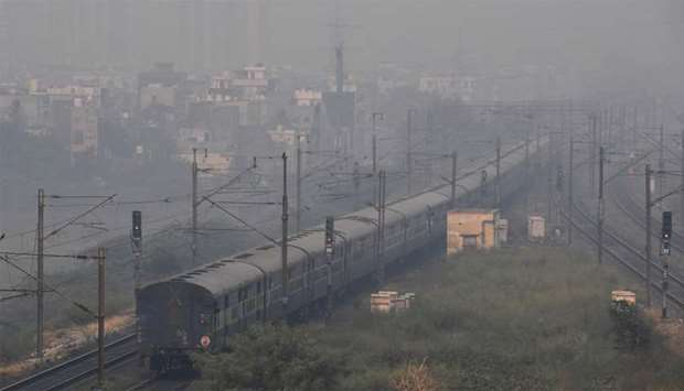 A train travels through heavy smog conditions in Ghaziabad on the outskirts of New Delhi