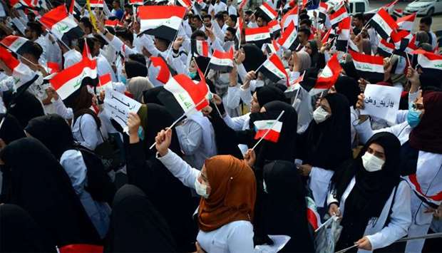 Iraqi medical students take part in an anti-government demonstration in the central city of Najaf
