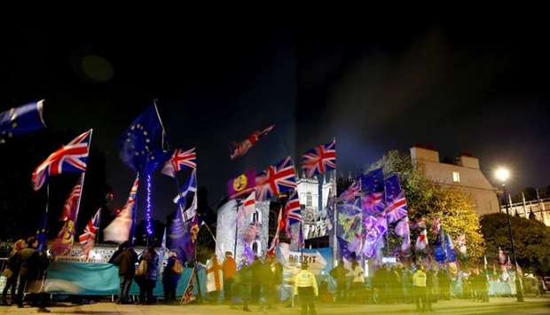Anti and pro-Brexit protesters demonstrate outside the Houses of Parliament in London
