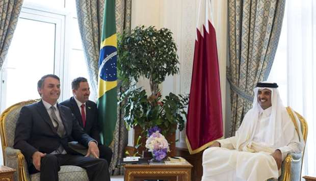 His Highness the Amir Sheikh Tamim bin Hamad al-Thani and Brazilian President Jair Bolsonaro holding